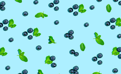 Wall Mural - Blueberries and mints on a solid color background