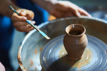 Master class on modeling of clay on a potter's wheel In the pottery workshop