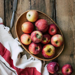 Red apples, harvest, wooden background, old boards, rustic style, top view