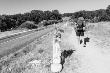 Camino de Santiago (Spain) - Pilgrims walking along the way of St.James, in the spanish meseta