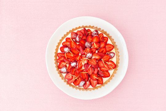Strawberry Tart with Lemon Cream on Pink Background