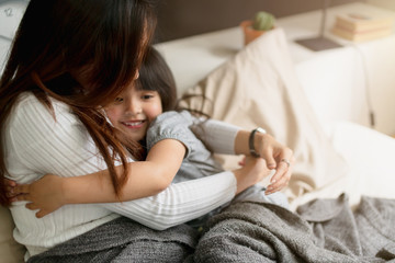beautiful single mom and daughter girl kid hug together with love and care on bed morning happiness weeked family concept