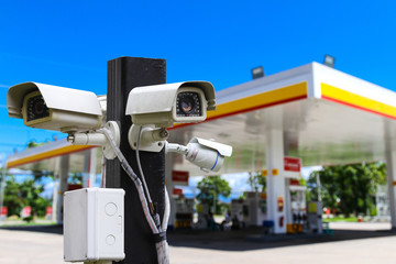 Outdoor and waterproof ip security surveillance video camera at a gas station.