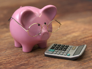 piggy bank with coins and Calculator,3d rendering,conceptual image.