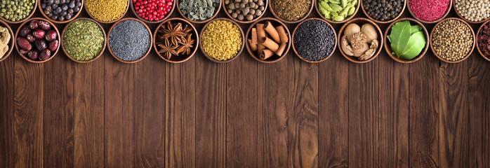 Fototapete - various spices and ingredients background. colorful seasonings, Indian food.