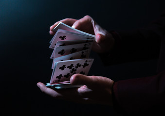 magician hands with playing cards