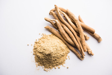 Ashwagandha / Aswaganda OR Indian Ginseng is an Ayurveda medicine in stem and powder form. Isolated on plain background. selective focus Wall mural