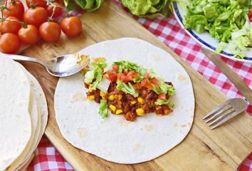 Chili Con Carne Burrito with fresh vegetable.