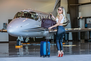 Glamorous Blonde Model Travels On A Private Jet For Her Vacation Wall mural