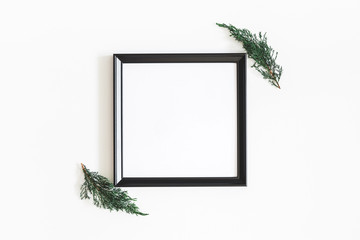 Christmas composition. Photo frame, fir tree branches on white background. Christmas, winter, new year concept. Flat lay, top view, copy space, square