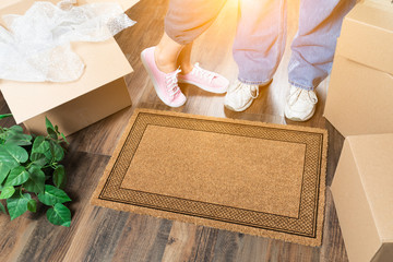 Man and Woman Standing Near Blank Welcome Mat, Moving Boxes and Plant