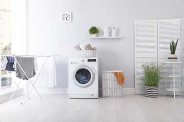 Laundry room interior with washing machine near wall Wall mural