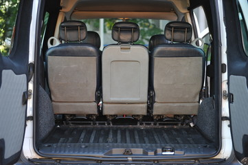 Leather back car seats with active headrest