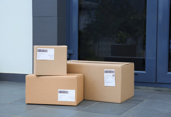 Parcel boxes on floor near office entrance