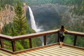 Tourist looking at Helmcken Falls in Wells Gray Provincial Park, British Columbia, Canada