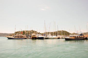 Sailing and motorboats in a calm harbor