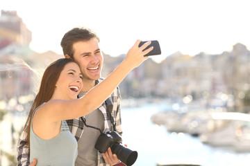 Couple taking selfies on summer vacation