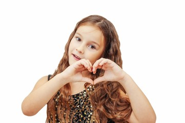 little girl with long hair holds her hands in a heart shape