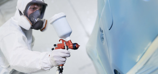automobile painting. car painter with gun in chamber Wall mural