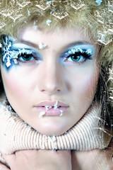 Beauty Winter Girl Blowing Snow in frosty winter