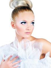 Beautiful woman with bright makeup. Fantasy girl portrait. Winter fairy portrait.