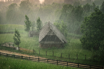 Old traditional house withstanding heavy rain