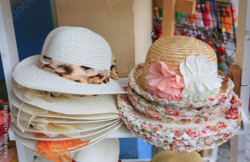 63311c3483798 Summer hats for sale in a market stall outdoor