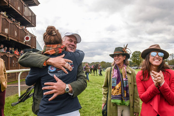 Horse owners celebrate after winning a race at the 98th Running of the Far Hills Race Meeting at Mooreland Farm in Far Hills