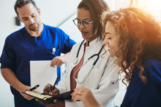 Diverse medical professionals talking together in a hospital cor