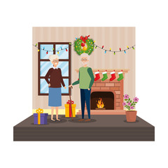 grandparents in livingroom with winter clothes and gifts