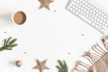 Christmas decorations, plaid, computer, fir tree branches, cup of coffee on white background. Christmas, new year, winter concept. Flat lay, top view, copy space