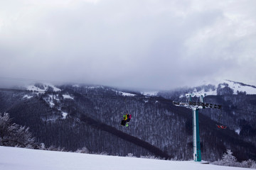 Cable car with skiers in the mountains, winter holidays, Ukrainian Carpathians, background