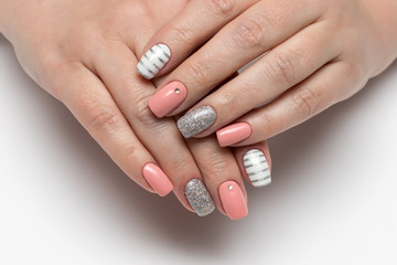 Poster de jardin Manicure Pink, beige white manicure with silver stripes, crystals, silver glitters on short square nails on a white background close-up