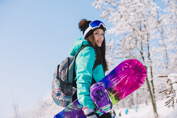Photo sur cadre textile Glisse hiver Leisure, winter, sport concept - person snowboarder going up with board