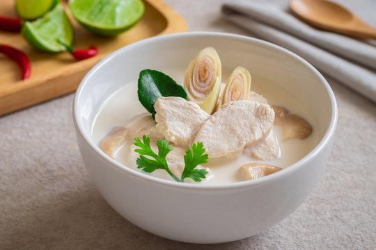 Chicken with coconut milk soup in white bowl, Thai food (Tom Kha kai).