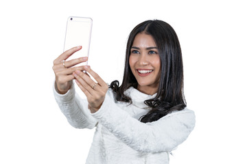 Portrait Asian woman taking selfie via technology smart mobile phone on white background, isolate include clipping path, fashion and lifestyle concept