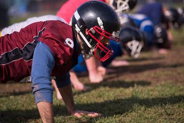 american football team doing push ups