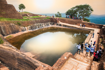 Tourists are waiting to climb on Sigiriya rock fortress in Sigiriya , Sri Lanka.