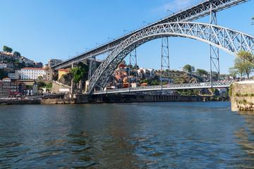 Scenic view of the bridge Dom Luis I Bridge from Vila Nova de Gaia. The river Douro, Porto, Portugal on the summer sunny day.