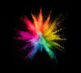 Colored powder explosion on black background