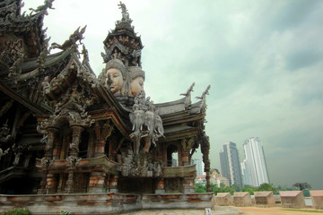 Sanctuary of Truth in Pattaya, Thailand. all-wood building filled with wooden sculptures based on traditional Buddhist and Hindu motives ans myths.