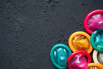 Colorful condoms with copy space over table