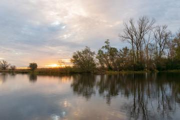 Sunrise on peaceful water