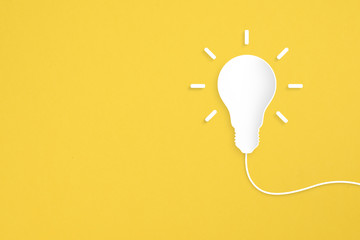 Paper light bulb on yellow background. Creative idea, New idea and Innovation concepts. Copy space