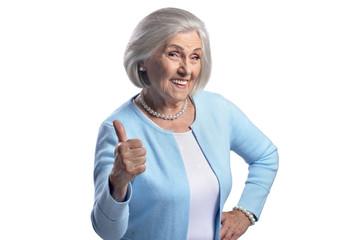 Beautiful senior woman showing thumb up on white background