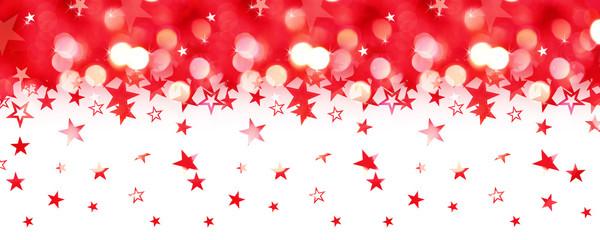 Shiny rain of red stars isolated on white background