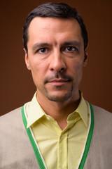 Portrait of handsome man against brown background