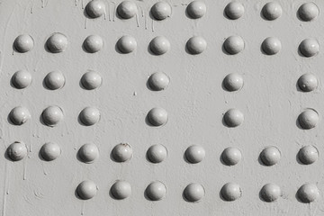 Grunge white metal iron texture background with buttons and space for text or image