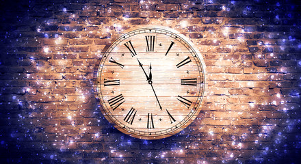 New Year's Hours.  Round wooden clock on the old brick wall, bokeh effect, celebratory, magic light, New Year, Christmas.