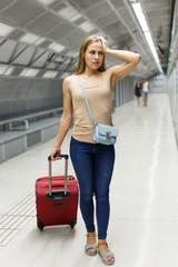 Concerned woman on subway platform